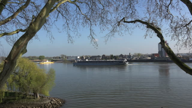 netherlands schoonhoven river lek with many barges time lapse - lek stock videos & royalty-free footage