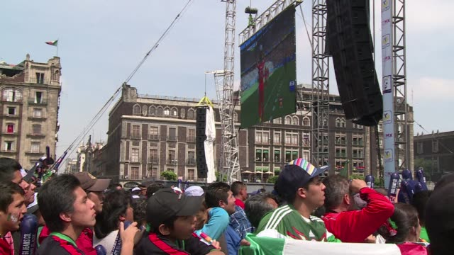 netherlands scored twice in the dying minutes of their world cup game against mexico turning cheers into tears in mexico citys central square - oranje stock videos & royalty-free footage
