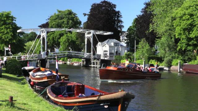 netherlands, vreeland. background drawbridge, yachts in river called vecht - utrecht stock videos & royalty-free footage