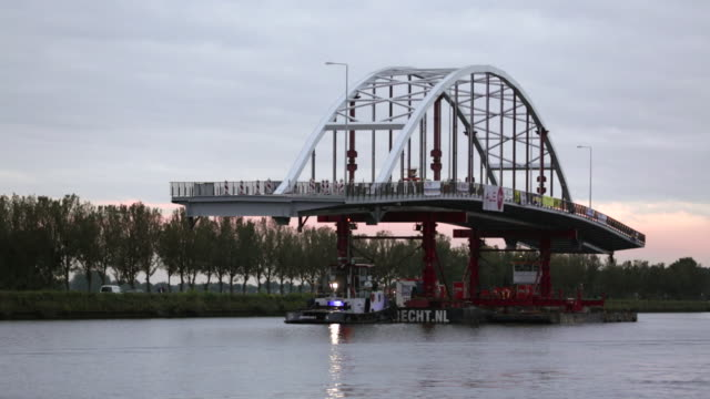 Netherlands, Weesp, Transport of new bridge on canal called Amsterdam-Rijnkanaal by Rijkswaterstaat, part of the Dutch Ministry of Infrastructure and the Environment