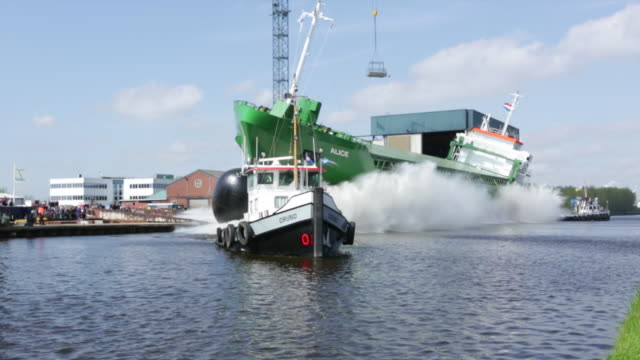 netherlands, westerbroek, launch of general cargo ship at the ferus smit shipyard, canal called winschoterdiep - ship launch stock videos and b-roll footage