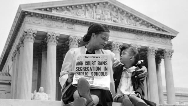 Nettie Hunt explains the Supreme Court's ruling in the Brown Vs. Board of Education case to her daughter Nickie on the U.S. Supreme Court Building steps in Washington, DC.