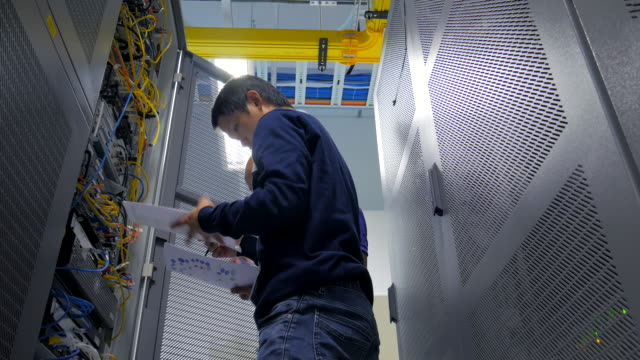 4K:A Network Engineer Checking netwrok equipment