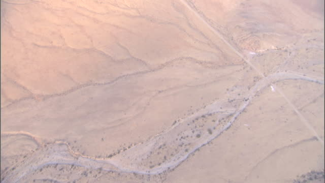 a network of roads and riverbeds criss-cross over the namib desert. available in hd. - remote location stock videos & royalty-free footage