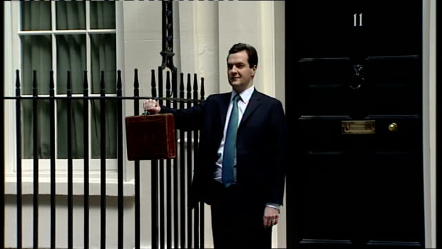 Network Rail criticised for awarding 6figure bonuses to top directors LIB EXT George Osborne MP posing with red budget box outside Number 11