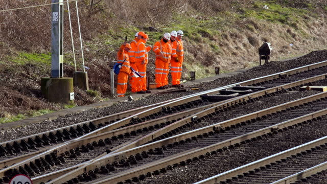 network rail engineers inspect the track on the west coast main line near crewe virgin/freight/arriva trains travel along the west coast main line at... - railway track stock videos & royalty-free footage