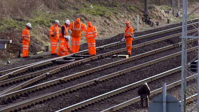 network rail engineers inspect the track on the west coast main line near crewe. virgin/freight/arriva trains travel along the west coast main line... - railway track stock videos & royalty-free footage