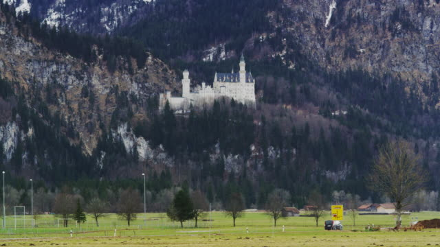neu schwanstein hill castle embedded by rugged hills - revival stock videos & royalty-free footage