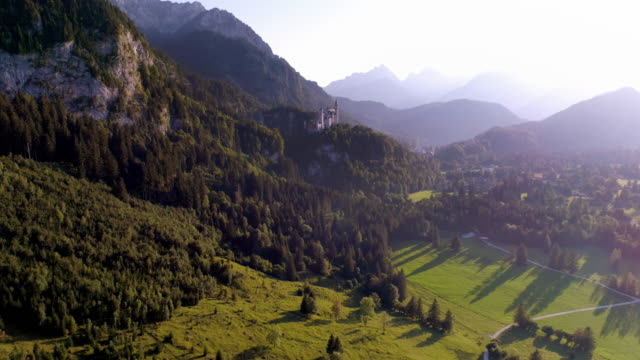 neuschwanstein castle and its surroundings in the evening sun - castle stock videos & royalty-free footage