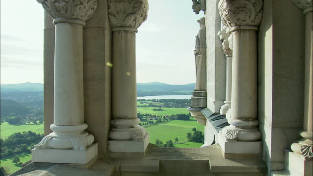 CU PAN WS Neuschwanstein Castle columns and mountain landscape with Lake Starnberg, Bavaria, Germany