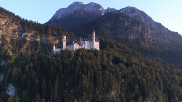 neuschwanstein castle in the evening sun - german culture stock videos & royalty-free footage