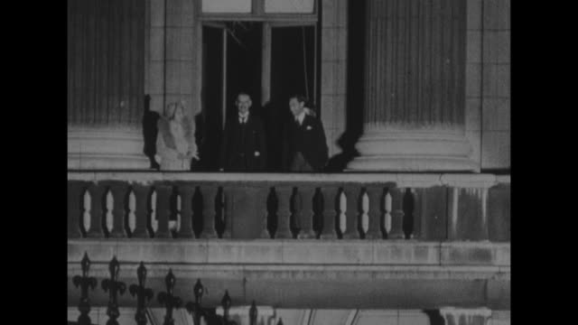 MS Neville and Anne Chamberlain on Buckingham Palace balcony at night with King George VI and Queen Elizabeth following Chamberlain's return from...