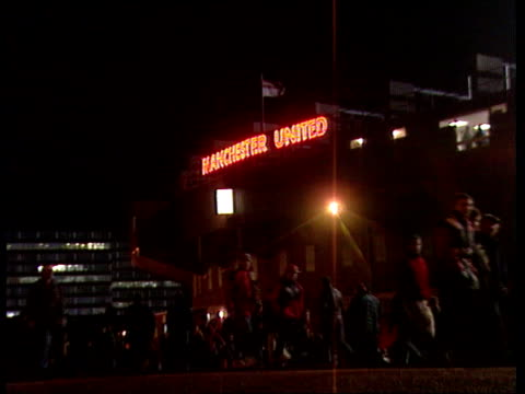 stockvideo's en b-roll-footage met neville brothers in england squad itn manchester old trafford lagv 'manchester united' neon sign outside football ground ms fans milling around... - 1996