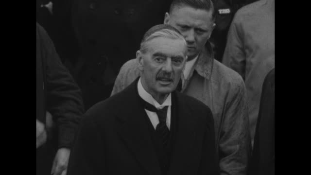 cu neville chamberlain reads munich agreement allowing adolf hitler to annex part of czechoslovakia to crowd we the german fuhrer and chancellor and... - 1938 stock-videos und b-roll-filmmaterial