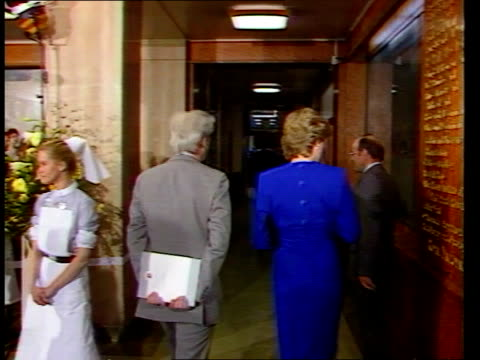 New AIDS ward/ Princess of Wales London Middlesex Hospital LMS Princess Diana and man walk thru door as nurses lined up inside ZOOM IN Diana chatting...