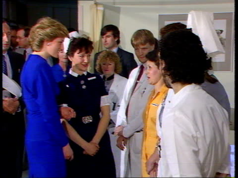 New AIDS ward/ Princess of Wales ENGLAND London Middlesex Hospital MS Princess Diana wearing knee length blue dress shakes staff in line MS Ward with...