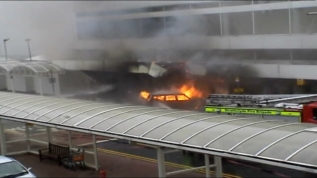 new al qaida tape threatens more attacks on britain; tx 30.6.2007 scotland: renfrewshire: glasgow airport: ext fire after jeep rammed into terminal... - the glasgow airport attack stock videos & royalty-free footage