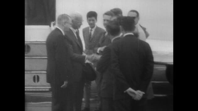 new ambassador to south vietnam ellsworth bunker arrives by plane in saigon / gets off plane and shakes hands with waiting men / walks into a... - vietnam meridionale video stock e b–roll