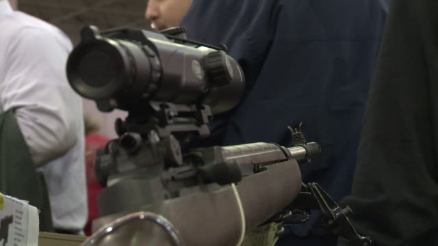 new and vintage handguns, hunting rifle and knives at the nation's gun show at the dulles expo center on december 28, 2012 in dulles, virginia - gun violence protest stock videos & royalty-free footage