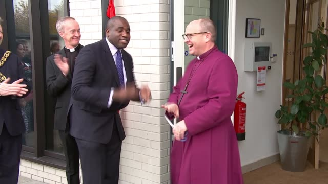 new anglican church opens in totteham hale; england: london: tottenham hale: ext the right reverend rob wickham speaking outside new church sot int... - anglican stock videos & royalty-free footage