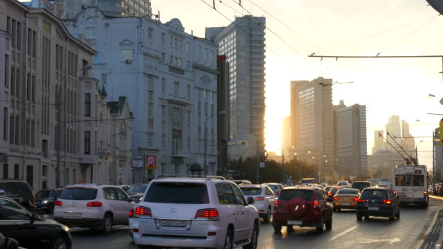 russia. moscow - 2015: 4k new arbat street and sun rays - ladenschild stock-videos und b-roll-filmmaterial