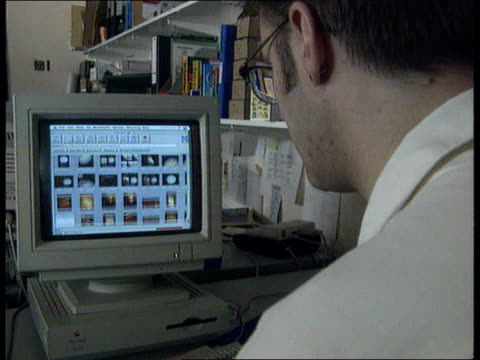 stockvideo's en b-roll-footage met new area codes launched lib hands typing on computer keyboard man sitting looking at internet page on computer hand operating mouse - 1990 1999