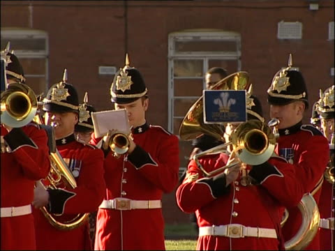new army barracks opened at tidworth garrison; ext 1st the queen's dragoon guards regimental band performing sot / members of the 2nd royal tank... - tidworth stock videos & royalty-free footage