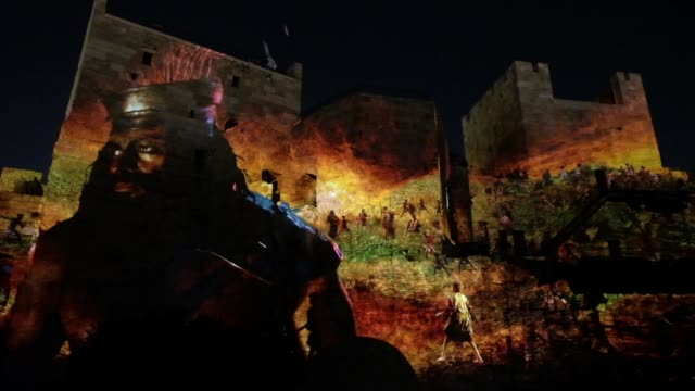 vídeos de stock, filmes e b-roll de a new audiovisual display is projected onto the walls and archaeological excavations of the ancient fortified tower of david also known as the... - israel
