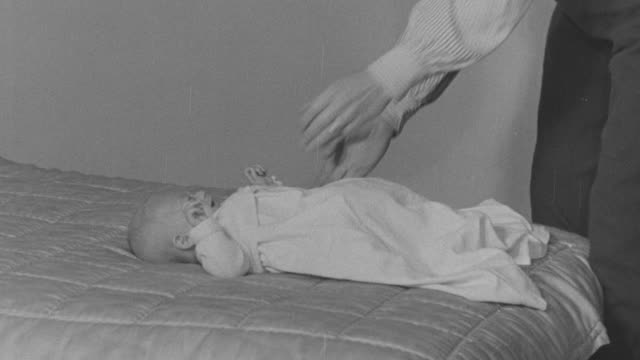 1947 montage new baby crying on bed until mother feeds him / united kingdom - 1947 stock videos & royalty-free footage