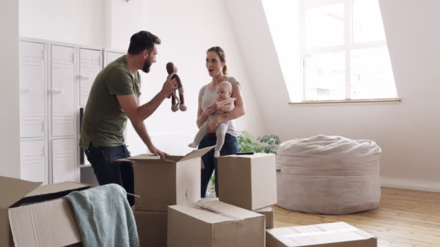 new baby, new house...life's perfect - unpacking stock videos & royalty-free footage
