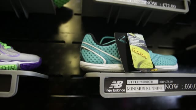 New Balance Athletic Shoe Inc trainers sit on display in the company's factory store in Flimby UK on Wednesday Aug 14 New Balance logo seen on...