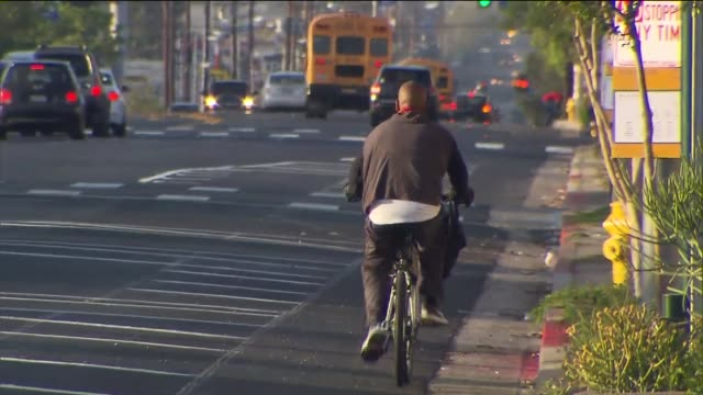new bikes lanes in northridge, ca on april 7, 2015. close-up/wide shot of bike lanes, close-up of man riding bike. - northridge stock videos & royalty-free footage