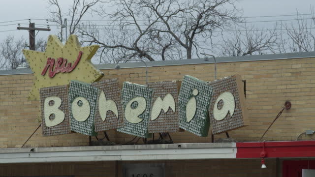 cu new bohemia store sign - store sign stock videos & royalty-free footage