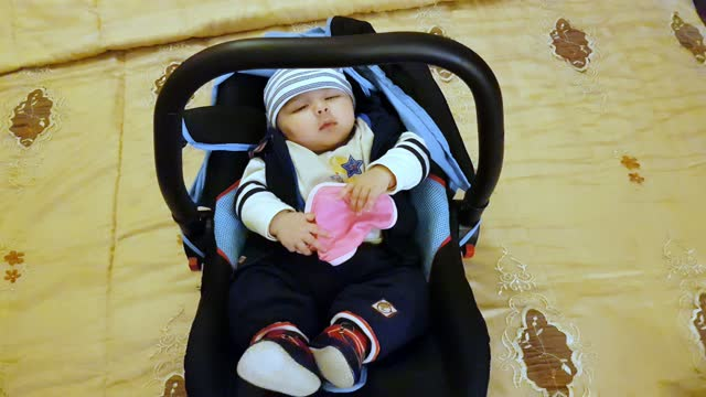 a new born baby girl trying to sleep in her cradle. - one baby girl only stock videos & royalty-free footage