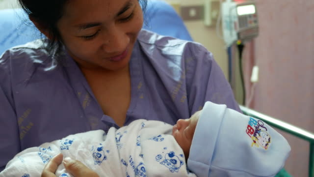 new born baby with his mother - newborn stock videos & royalty-free footage