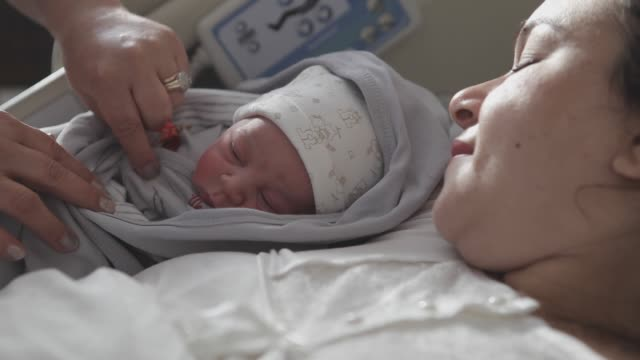 new born baby with his mother - childbirth stock videos & royalty-free footage