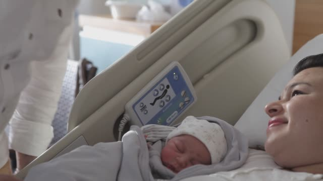 new born baby with his parent - two parents stock videos and b-roll footage