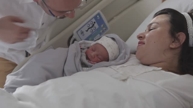 New born baby with his parent