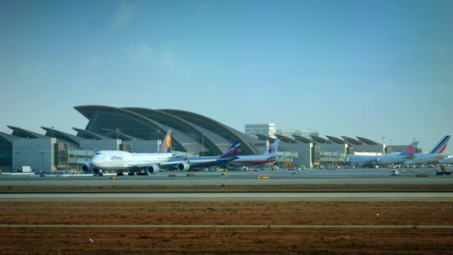 W/S new Bradley International terminal at LAX, Lufthansa Boeing-747 leaving gate for departure