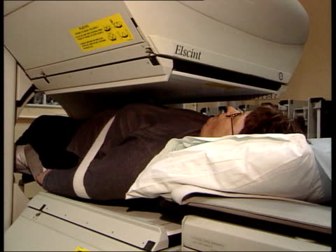 new breast cancer scanning technique england london st bartholomew's i/c sue lumsden on bed on scanning machine as moved into machine ms scanning... - lymphatic system stock videos & royalty-free footage