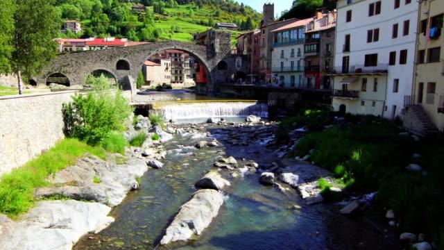 new bridge (camprodon), ter river - springtime - puente stock videos & royalty-free footage