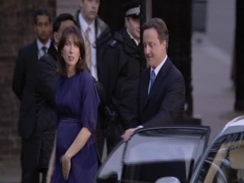 New British Prime Minister David Cameron arrives at 10 Downing Street with wife Samantha after forming a political alliance with the Liberal...