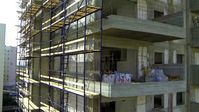 new building construction - scaffolding stock videos & royalty-free footage