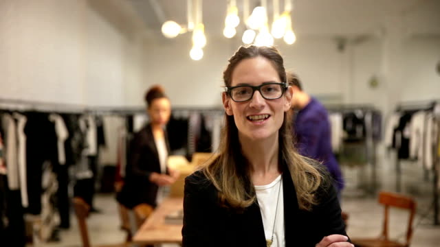 new business employee of a clothing store - manager stock videos and b-roll footage