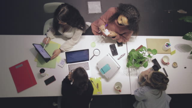 new business startup: all women team work together in coworking office - partnership stock videos & royalty-free footage