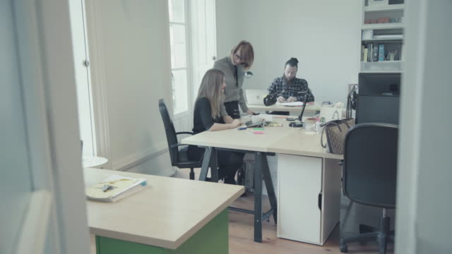 new business team: at work together in the startup office - netbook stock videos and b-roll footage
