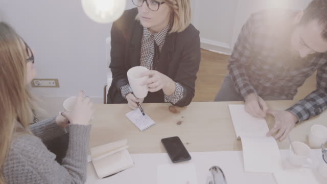 new business team: at work together in the startup office - coworking space stock videos and b-roll footage