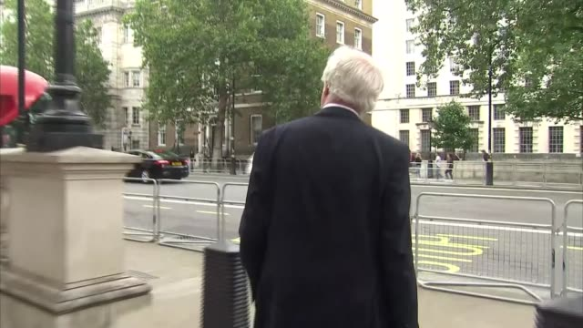 new cabinet minister doorsteps; david davis outside 70 whitehall, ignores questions and along / gavin williamson mp along - david m. davis politician stock videos & royalty-free footage
