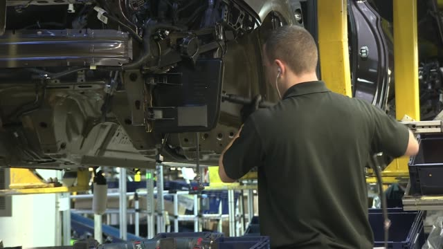 New car sales slump for first time in 6 years R03031615 / 332016 Ellesmere Port Vauxhall car plant Various of workers working on cars on Vauxhall...