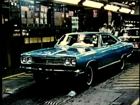 montage, new cars in factory, 1960's, detroit, michigan, usa - 1960 1969 stock-videos und b-roll-filmmaterial